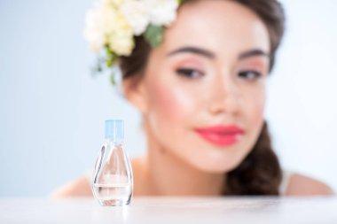 Woman looking at perfume