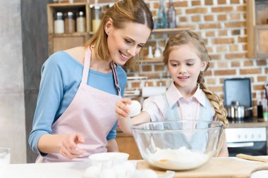 Mother and daughter preparing dough