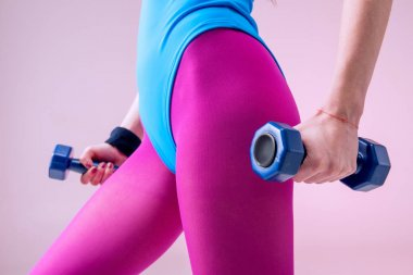Sporty woman holding dumbbells