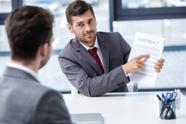 Businessmen discussing contract