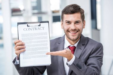 Businessman holding contract
