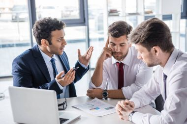 Businessmen discussing charts