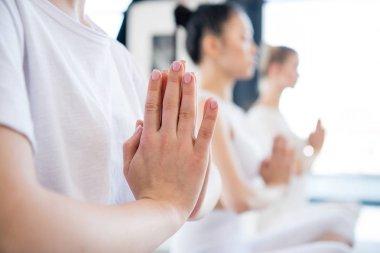 Young women meditating in lotus pose
