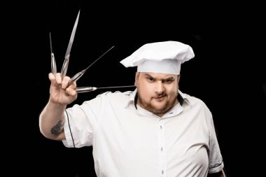 Professional chef with knives