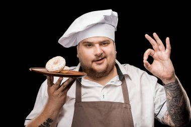 Chef with doughnuts on plate