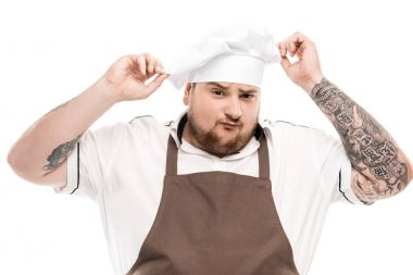 Cooker in apron and chef hat