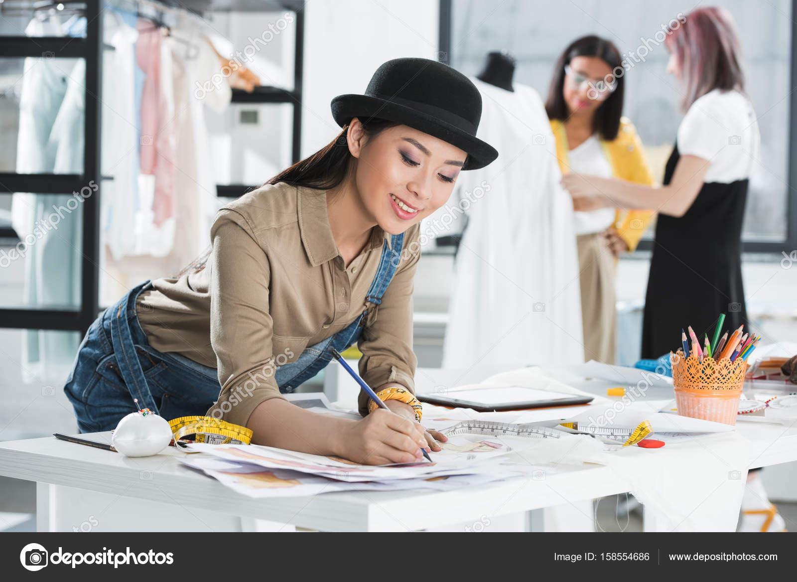 Asian fashion designer working stock photo dmitrypoch Japanese clothing designers