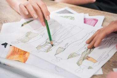 Fashion designers working with blueprints