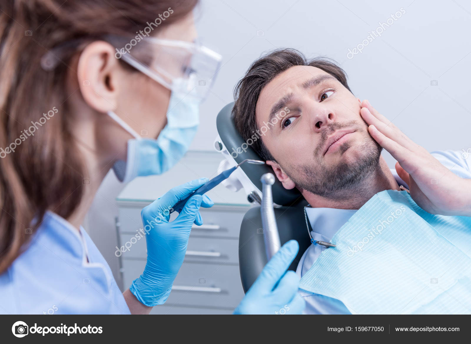 Dentist And Scared Patient Stock Photo 159677050