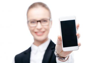 Businesswoman presenting smartphone