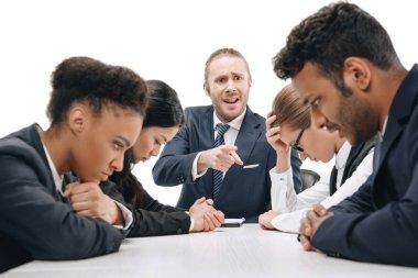 Businessman quarreling at colleagues