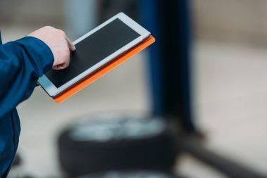 Male hand using digital tablet