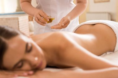 Massage therapist with body oil