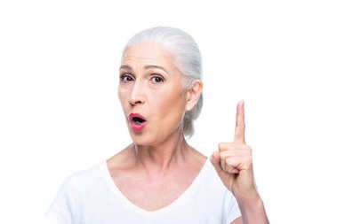 Senior woman pointing up