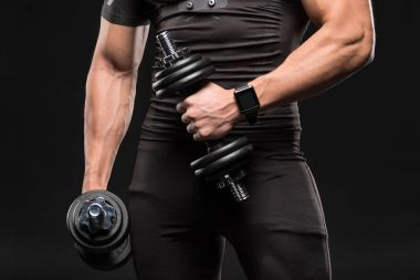 Muscular man with dumbbells