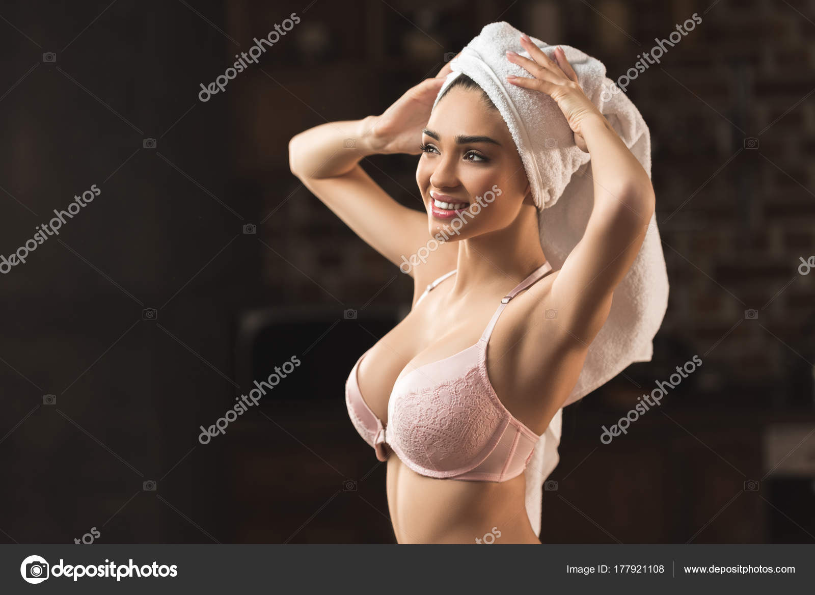 5793f75d6ff5 Beautiful sexy young woman in underwear and towel on head smiling and  looking away at home– stock image