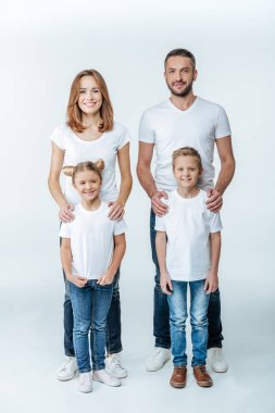 Smiling family in white t-shirts