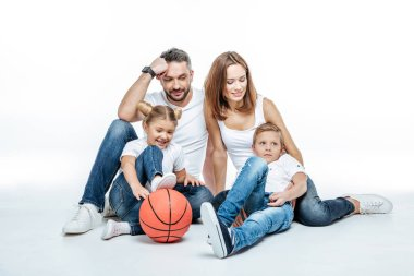 Family sitting with basketball ball