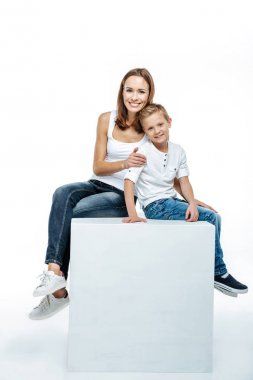 Smiling mother with son sitting togethe