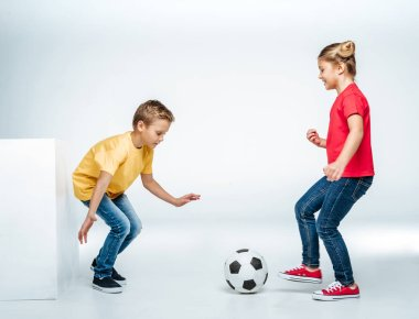 siblings playing with soccer ball