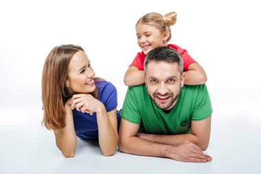 Smiling parents with cute little daughter