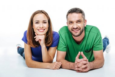 Couple lying and looking at camera