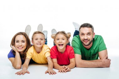 Happy family in colored t-shirt