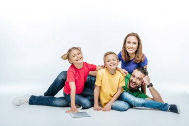 Family lying together with digital tablet