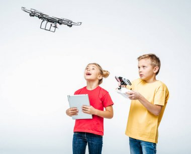 Kids using digital tablet and hexacopter drone