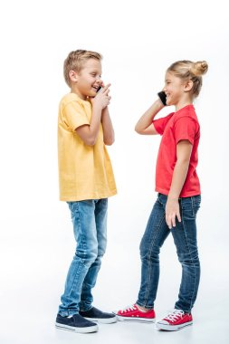 Happy kids talking on mobile phones
