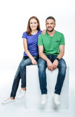 Young couple looking at camera