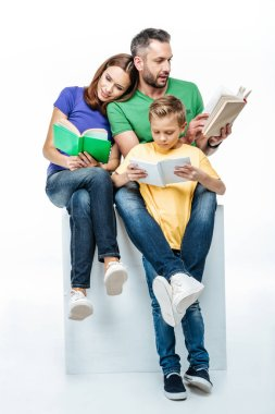 family with one child reading books