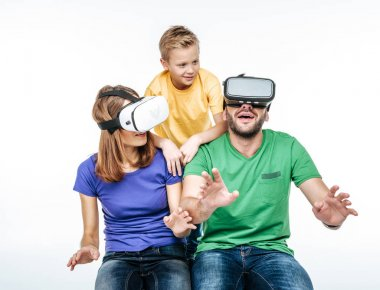 Family using virtual reality headsets
