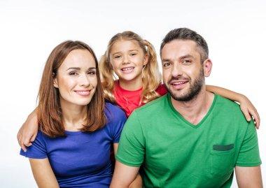 Happy family looking at camera