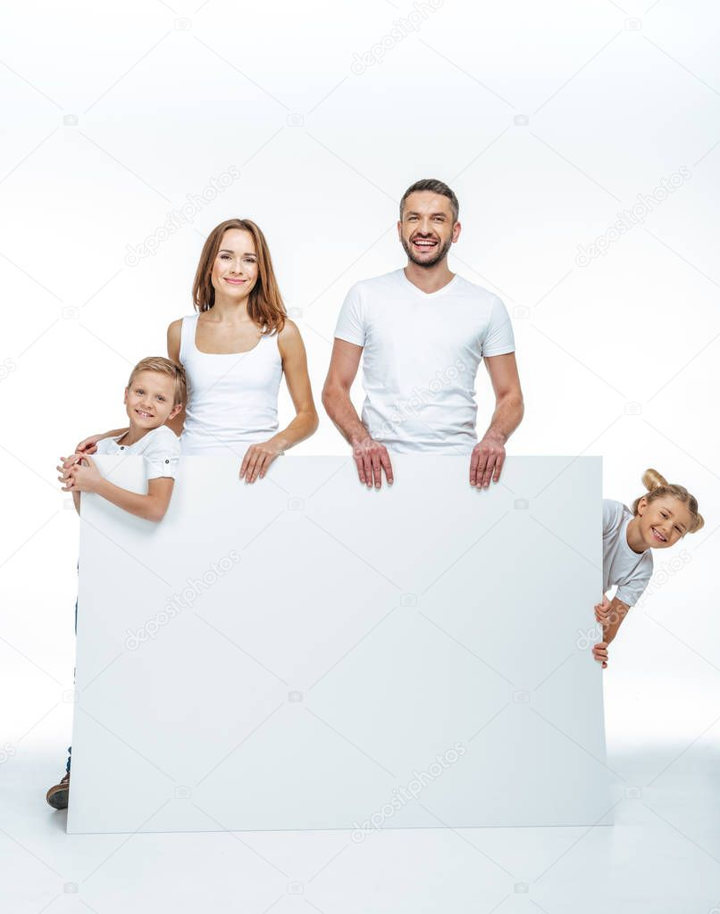 Happy family holding blank card