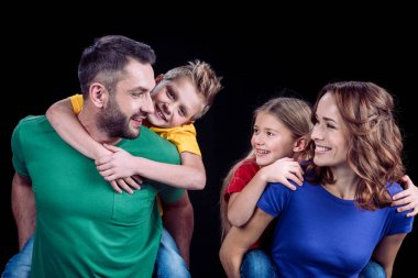 Happy family in colorful t-shirts