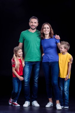 Happy family standing together