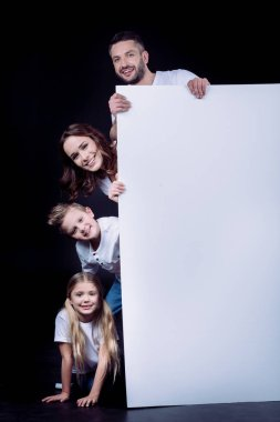 Happy family holding blank card