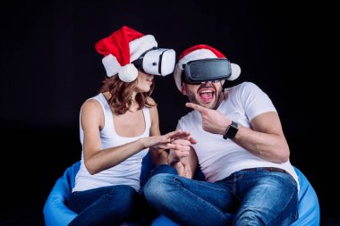 couple using virtual reality headsets