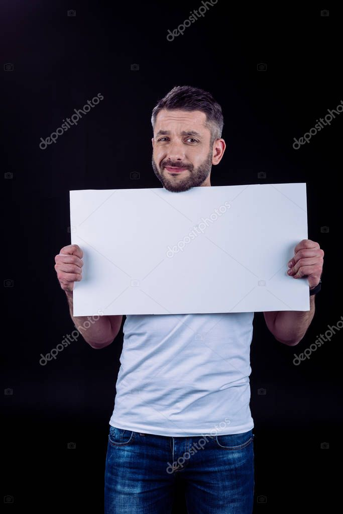 Smiling man holding blank card