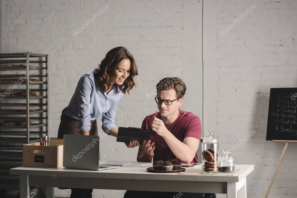 Man and woman discussing notes