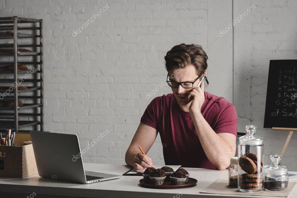 Serious man using smartphone