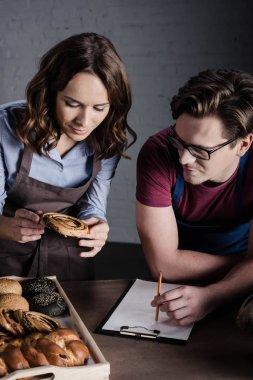 Bakers examining pastries