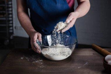 Baker sifting flour