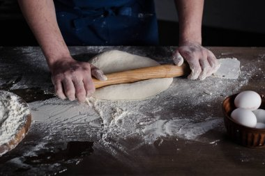 Baker rolling dough