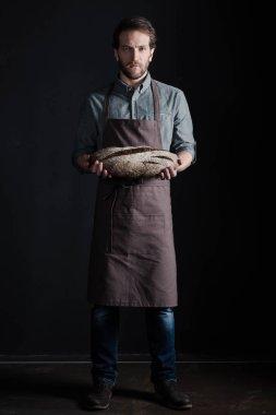 Baker holding bread