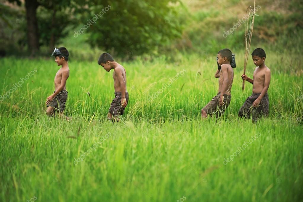 Happy Asian children on field.