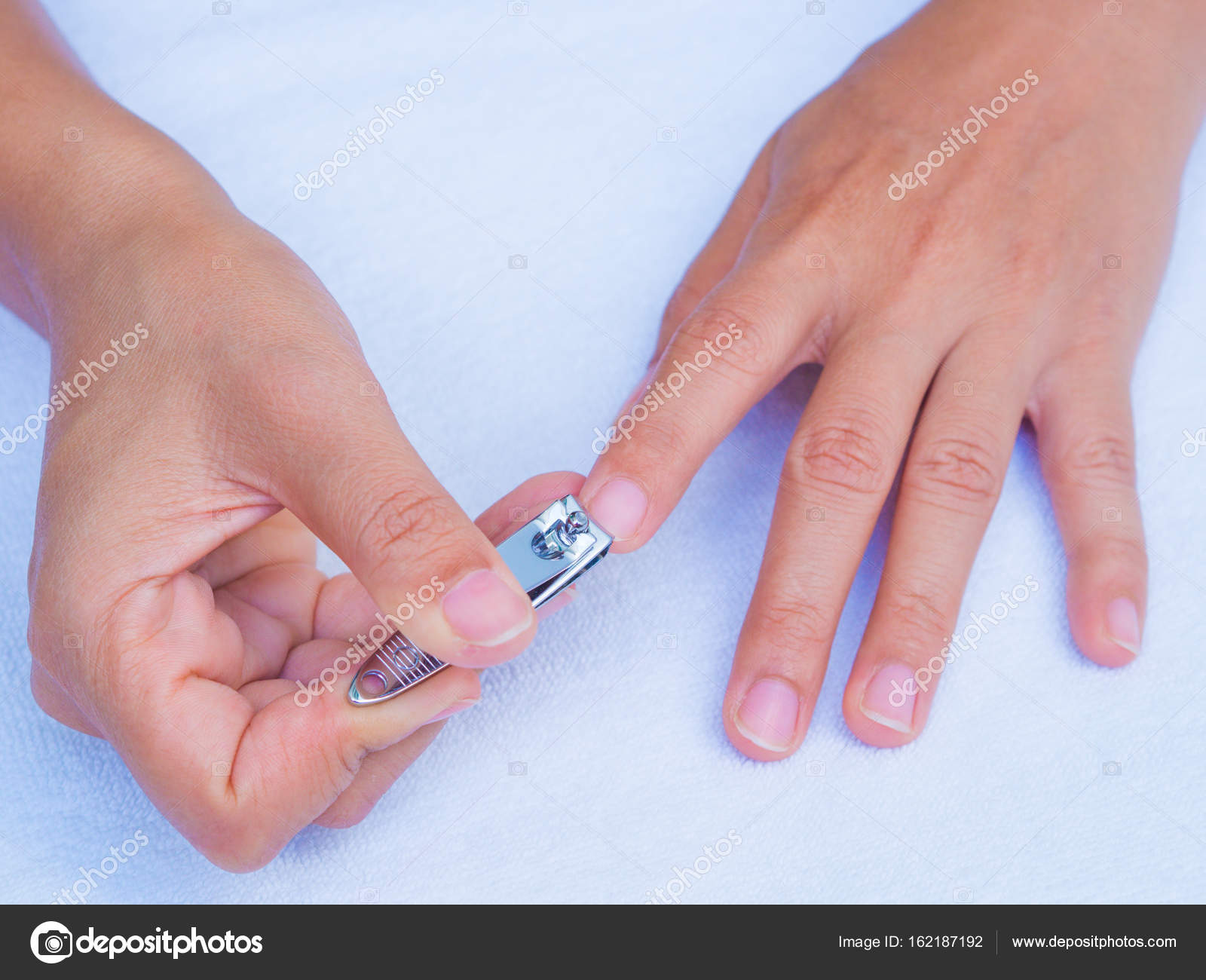 closeup of a woman cutting nails, health care concept. — Stock Photo ...