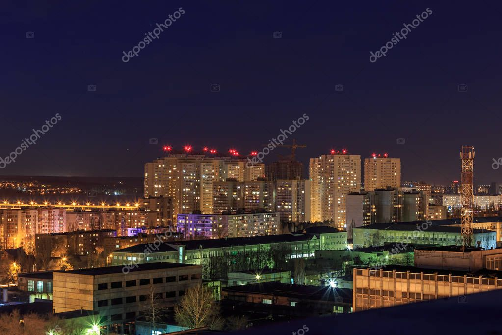 Night cityscape view to urban modern apartment buildings in Voronezh