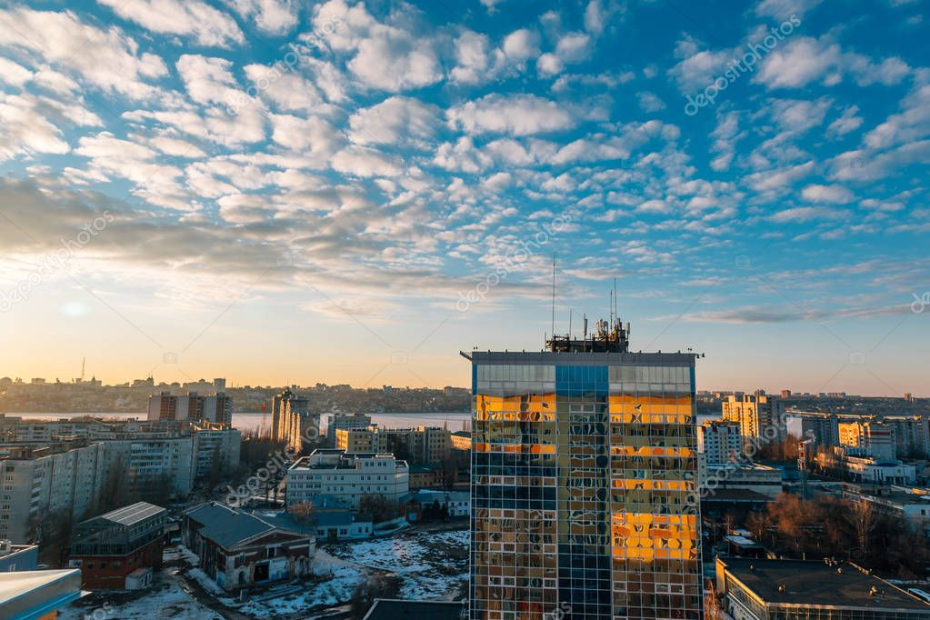 Urban cityscape at sunset, Voronezh city, panorama with city line, clouds